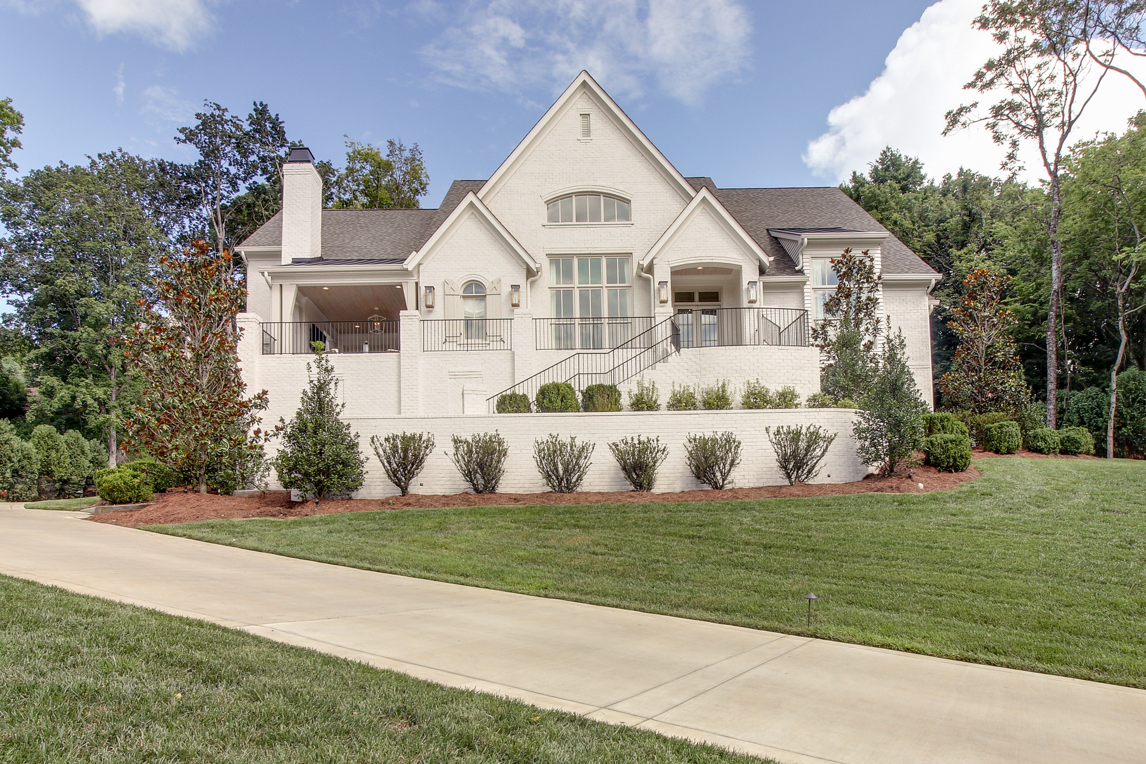 New homes with stairs to back door by fine home builder in Franklin, Brentwood, and Thompson Station TN with Custom Home Design