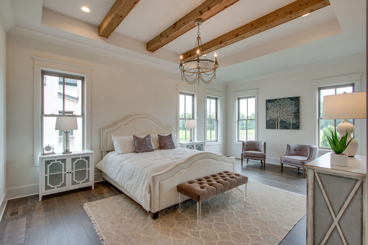 Master bedroom that was custom built with modern interior design for a new home in Brentwood TN