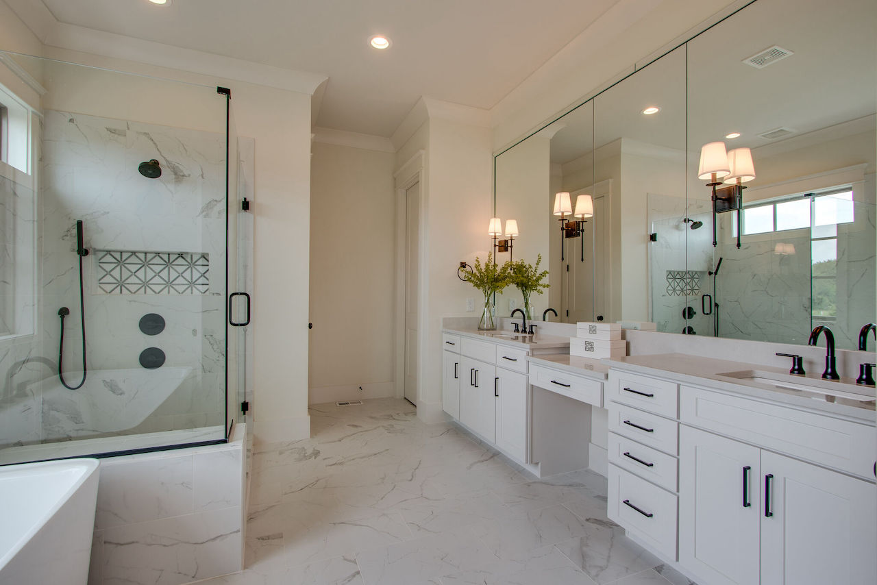 Modern bathroom with lights and white cabinets from nashville home builders for a new home in Franklin TN