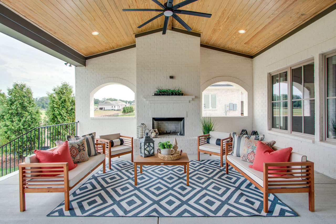 fancy outdoor patio that was designed by custom home builders in nashville for a new home in Thompson Station TN