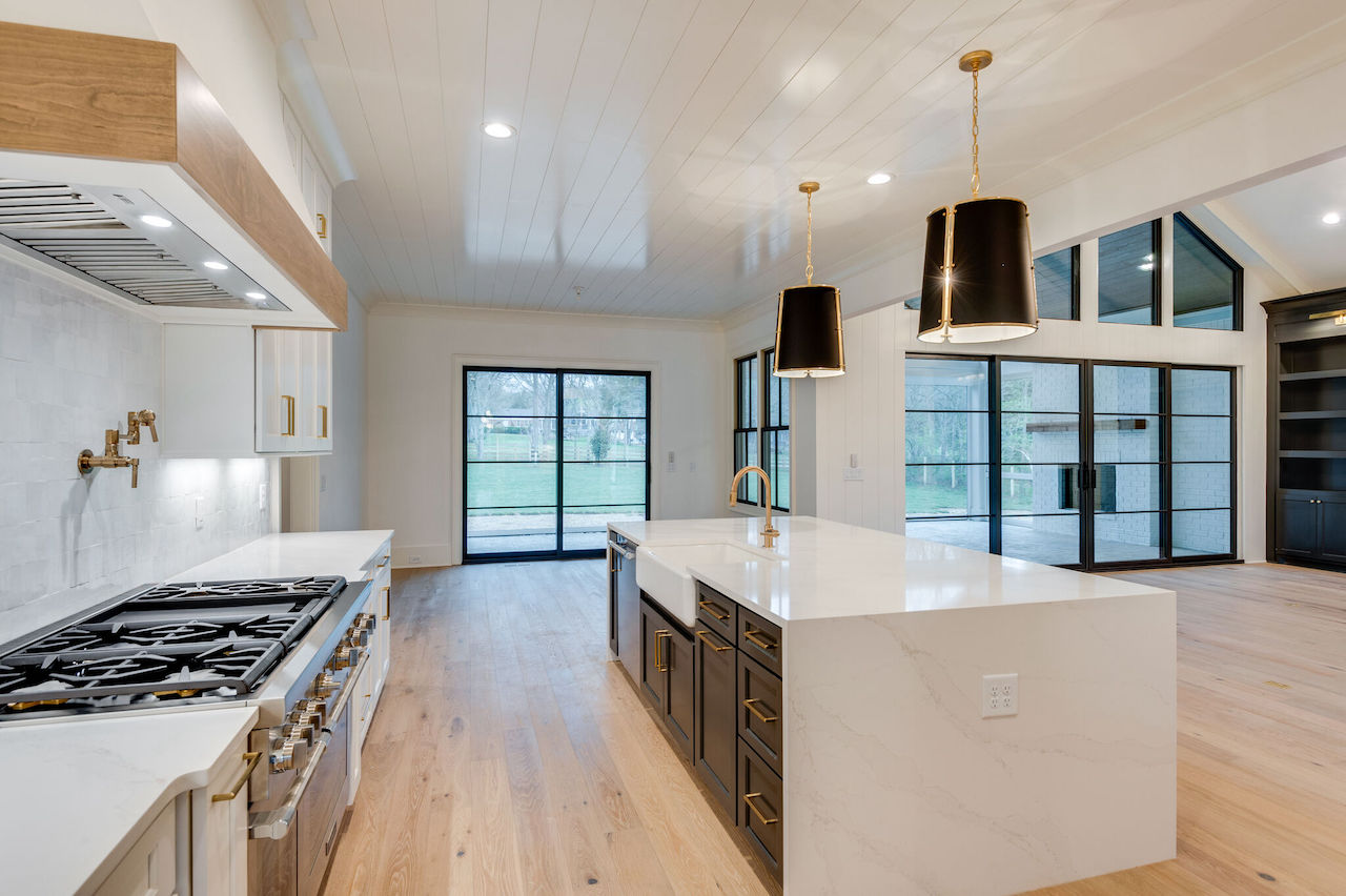 modern kitchen that was custom built by nashville home builders for a New Home in Brentwood TN