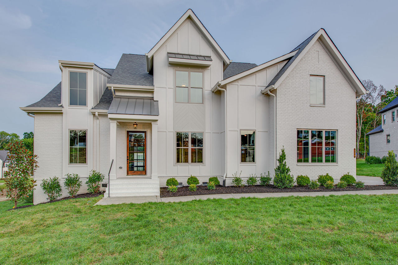 white home that is two stories from Nashville Home Builders for New Homes Brentwood TN